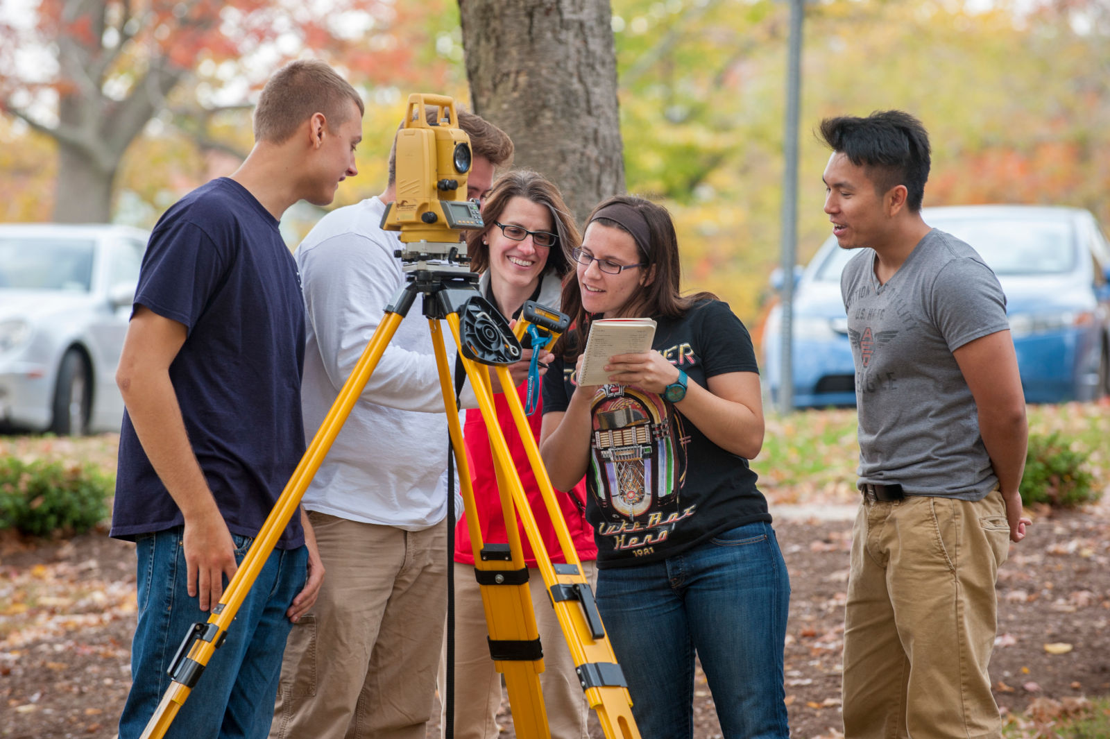Students with professor during a surveying class on Oct. 22, 2015. (Sean Flynn/UConn Photo)