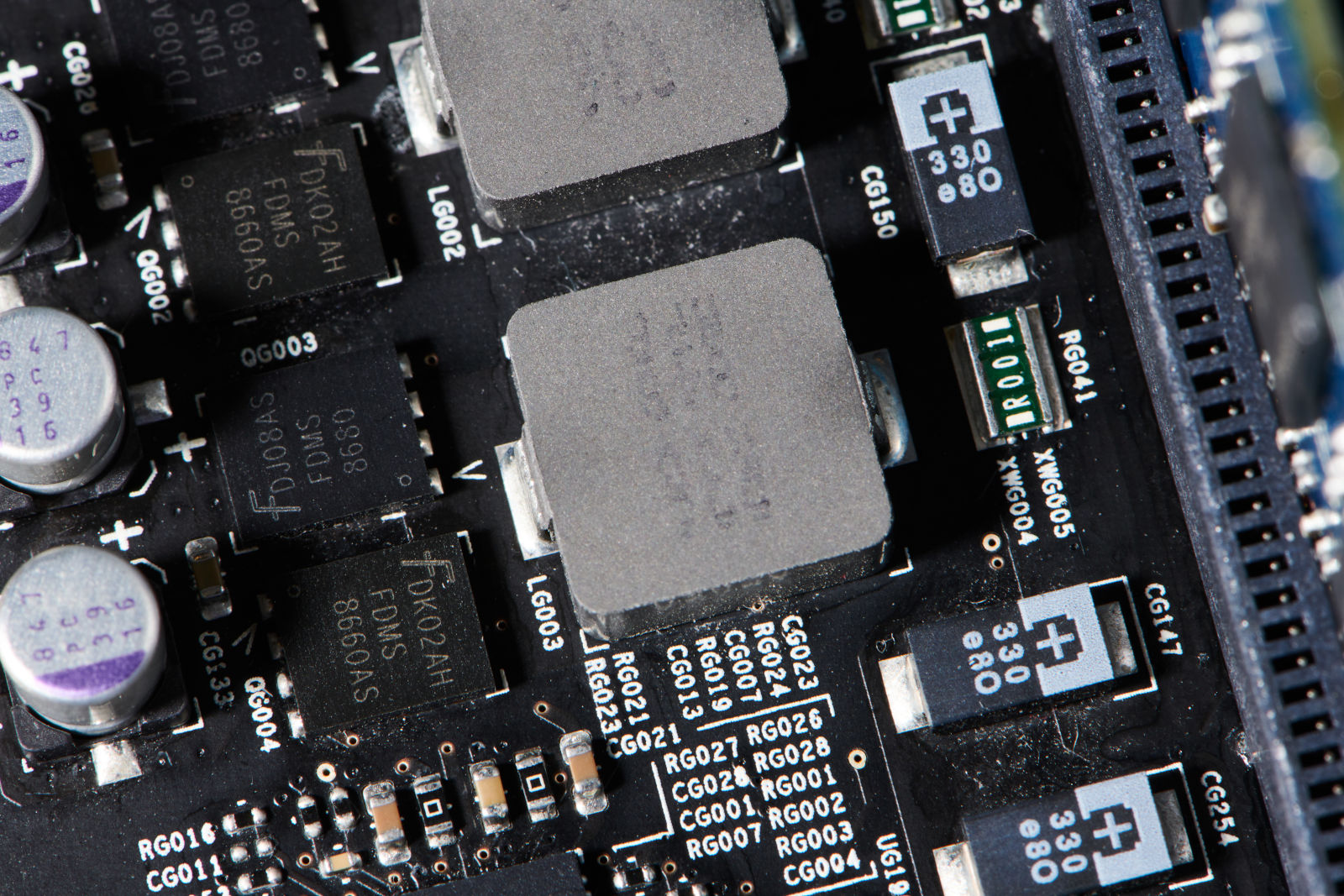 Integrated circuit chips, resistors and capacitors on a computer motherboard on March 12, 2021. (Peter Morenus/UConn Photo)